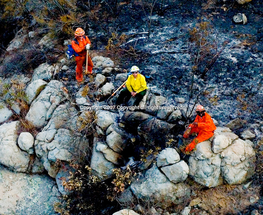Aerial view of Firefighters on California mountainside.  Wildfire's Destruction on the California landscapes.