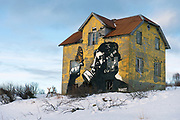 Old, decorated house at Gimsöya, Lofoten, Norway. Photo from February 2013.