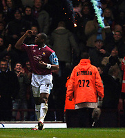 Photo: Daniel Hambury.<br />West Ham United v Bolton Wanderers. The FA Cup. 15/03/2006.<br />West Ham's Marlon Harewood celebrates his goal as a flare is thrown onto the pitch behind him..