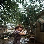 Flor Portilla outside her home in East Houston, Texas after Hurricane Harvey on Tuesday, August 30, 2017. John Taggart for The Washington Post