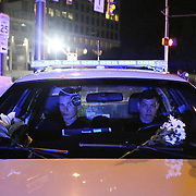Charlotte, NC- September 23, 2016:  Two Charlotte Mecklenburg Police officers block an intersection as flowers are placed on the windshield of their cruiser. CREDIT: LOGAN R. CYRUS FOR THE NEW YORK TIMES