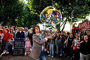 Samsam Bubbleman entertaining the visiters to the Thames Festival 08 with a giant bubble as one of the activities along the southbank of the Thames. September 2008