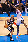 June 2, 2012; Oklahoma City, OK, USA; San Antonio Spurs guard Tony Parker (9) looks to make a pass under pressure from Oklahoma City Thunder forward Serge Ibaka (9) during a playoff game  at Chesapeake Energy Arena.  Thunder defeated the Spurs 109-103 Mandatory Credit: Beth Hall-US PRESSWIRE