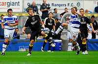 Photo: Leigh Quinnell.<br /> Queens Park Rangers v Cardiff City. Coca Cola Championship. 18/08/2007. Cardiffs Paul Parry battles with QPRs Martin Rowlands.
