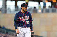 Mike Pelfrey #37 of the Minnesota Twins reacts after a runner was called safe at 1st base in Game 2 of a split doubleheader against the Miami Marlins on April 23, 2013 at Target Field in Minneapolis, Minnesota.  The Marlins defeated the Twins 8 to 5.  Photo: Ben Krause