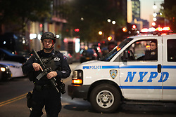 NEW YORK, Oct. 31, 2017  A police officer stands guard near the site of an attack in lower Manhattan in New York, the United States, on Oct. 31, 2017. Eight people were killed and a dozen more injured after a truck plowed into pedestrians near the World Trade Center in New York City, the mayor said on Tuesday. (Credit Image: © Wang Ying/Xinhua via ZUMA Wire)