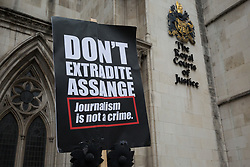 A placard placed by supporters of Wikileaks founder Julian Assange outside the High Court following a March for Assange from BBC Broadcasting House organised by the Don't Extradite Assange campaign is pictured on 23rd October 2021 in London, United Kingdom. The US government will begin a High Court appeal on 27th October against a decision earlier this year not to extradite Assange to face espionage charges in the United States. Assange has been held in Belmarsh Prison since 2019. (photo by Mark Kerrison/In Pictures via Getty Images)