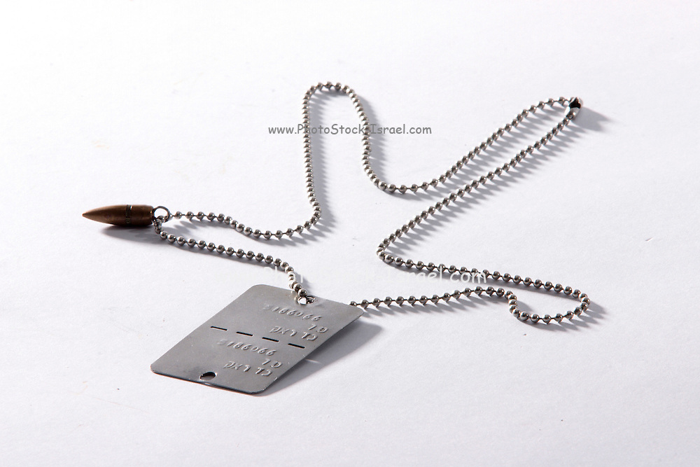 Israeli military dogtag on a chain with a bullet on a white background