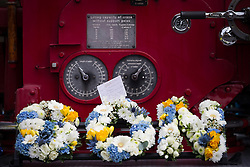© Licensed to London News Pictures . 02/09/2013 . Bury , UK . Flowers and tributes placed on the vintage fire engine that carried the coffin to the church . The funeral of fireman Stephen Hunt at Bury Parish Church today (Tuesday 3rd September 2013) . Stephen Hunt died whilst tackling a blaze at Paul's Hair World in Manchester City Centre in July 2013 . Photo credit : Joel Goodman/LNP