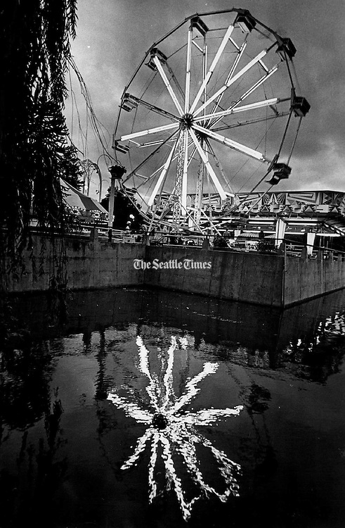 Lights of a Ferris wheel reflected in a pool at the Seattle Center. (Greg Gilbert / The Seattle Times, 1973)