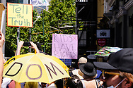 A people protesting the state government's lockdown hold a protest signs in Bourke Street. The groups who have organised the many Freedom Day protest over the last 3 months, attempted to march to State Parliament on Melbourne Cup Day demanding the sacking of Premier Daniel Andrews for the lockdown and attacks on their civil liberties, where they were met with a heavy police presence.  (Photo by Michael Currie/Speed Media)