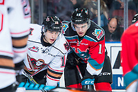 KELOWNA, CANADA - OCTOBER 13: Jakob Stukel #10 of the Calgary Hitmen lines up against Erik Gardiner #12 of the Kelowna Rockets on October 13, 2017 at Prospera Place in Kelowna, British Columbia, Canada.  (Photo by Marissa Baecker/Shoot the Breeze)  *** Local Caption ***