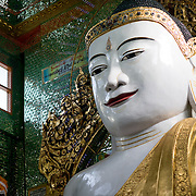 Buddha statue at Soon Oo Pon Nya Shin Pagoda. Sitting on top of Nga-pha Hill, Soon Oo Pon Nya Shin Pagoda is one of multiple pagodas and temples in the religious district of Sagaing, near Mandalay. The original pagoda dates to 674.