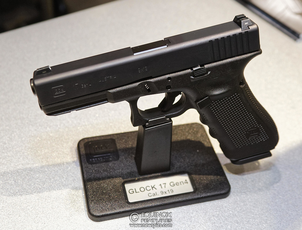 London, United Kingdom - 16 September 2015<br /> Glock hand guns including the Glock 17 gen 4 model which is supplied to the UK Ministry of Defence, on display at the annual defence and security exhibition DSEI at ExCeL, Woolwich, London, England, UK.<br /> (photo by: EQUINOXFEATURES.COM)<br /> <br /> Picture Data:<br /> Photographer: Equinox Features<br /> Copyright: ©2015 Equinox Licensing Ltd. +448700 780000<br /> Contact: Equinox Features<br /> Date Taken: 20150916<br /> Time Taken: 11183752<br /> www.newspics.com