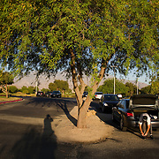 Golden State Golf Tour player Scott Clayton prepares for the day's round in the parking lot. There are no locker facilities like on the PGA Tour.