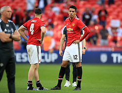 Manchester United's Chris Smalling (right) and Phil Jones stand dejected after the game