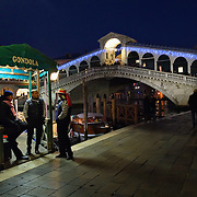 VENICE, ITALY - DECEMBER 08:  Three gondoliers chat near a Christmas decorated Rialto Bridge on December 8, 2011 in Venice, Italy. HOW TO LICENCE THIS PICTURE: please contact us via e-mail at sales@xianpix.com or call our offices in London   +44 (0)207 1939846 for prices and terms of copyright. First Use Only ,Editorial Use Only, All repros payable, No Archiving.© MARCO SECCHI