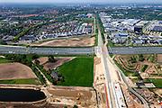 Nederland, Noord-Brabant, Den Bosch, 09-05-2013; werkzaamheden aan de Zuid-Willemsvaart. Kruising met spoorlijn, gezien in de richting van Den Bosch.Het kanaal wordt verbreed, uitgegraven en omgelegd - zodat de binnenstad van Den Bosch vermeden kan worden. Het gaat niet alleen om een omlegging, maar ook om een opwaardering zodat grote schepen van het kanaal gebruik kunnen blijven maken.<br /> View on works on the Zuid-Willemsvaart (channel) next to motorway A2 and crossing the railway,  near Den Bosch (Southern Netherlands).<br /> luchtfoto (toeslag op standard tarieven);<br /> aerial photo (additional fee required);<br /> copyright foto/photo Siebe Swart.