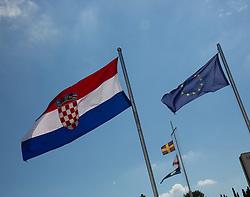 11.09.2013, Rovinj, CRO, EU Beitritt Kroatien, im Bild EU-Beitritt Kroatien, Fahnen der EU und der von Kroatien wehen an einer Hafeneinfahrt in Rovinj, Istrien, Kroatien, Symbolbild, Symbol, symbolisch, Querformat, quer, landscape, horizontal // Croatia EU accession in Rovinj, Croatia on 2013/09/11. EXPA Pictures © 2013, PhotoCredit: EXPA/ Eibner/ Klaus Rainer Krieger<br /> <br /> ***** ATTENTION - OUT OF GER *****