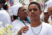 Bahianas in tradtional Candomble Umbanda dress gathered outside the church, Every second 2nd Thursday in February thousands of people attend the Lavagem do Bonfim - The washing of Bonfim at the Iglesia do Bonfim - Church of Bonfim in Salvador de Bahia,