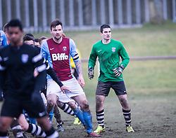 Whitehill Welfare Andrew Kidd and Edusport Academy keeper Antoine Marguin.<br /> Whitehill Welfare 2 v 1 Edusport Academy, South Challenge Cup Quarter Final played 7/3/2015 at Ferguson Park, Carnethie Street, Rosewell.