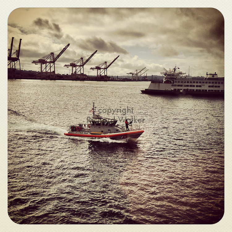 2013 September 21 - Coast Guard escort boat alongside a Washington State Ferry in Puget Sound, Seattle, WA, USA. Taken/edited with Instagram App for iPhone. By Richard Walker
