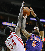 Jan 28, 2012; Houston, TX, USA; Houston Rockets power forward Patrick Patterson (54) fouls New York Knicks center Tyson Chandler (6) during the second quarter at the Toyota Center. Mandatory Credit: Thomas Campbell-US Presswire