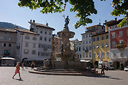 Eighteenth century Neptune fountain in Piazza Duomo, Trento. We see a wide view of the Piazza with the late Baroque Fountain of Neptune (Fontana di Nettuno) built in 1767-1768. The oldest centre of Trento offers interesting architecture with a unique feel of both Italian Renaissance and Germanic influences.