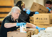 Harris County Department of Education staff pack boxes with food items for distribution to to more than 1300 families of Head Start student served by HCDE, March 25, 2020.