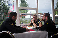 Simon Trummer (CHE) / Oliver Webb (GBR) / Pierre Kaffer (DEU) driving the #4 LMP1 Bykolles Racing Team CLM P1/01 - AER discuss tactics over lunch 24hr Le Mans 16th June 2016
