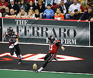 Jason Ball kicks off to New York during the Gladiators' 61-48 win in their Arena Football League debut on March 3, 2008 at Quicken Loans Arena in  Cleveland against visiting New York Dragons.Ryan Bowers is also in on the play.