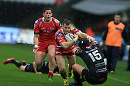 Gareth Davies of the Scarlets goes past Dan Evans (15) of the Ospreys to set up the 1st half try from DTH Van Der Merwe of Scarlets. Guinness Pro12 rugby match, Ospreys v Scarlets at the Liberty Stadium in Swansea, South Wales on Saturday 26th March 2016.<br /> pic by  Andrew Orchard, Andrew Orchard sports photography.