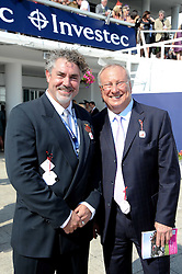 Left to right, RAYMOND VAN NIEKERK Global Head of Marketing at Investec and BERNARD KANTOR CEO of Investec at the Investec Ladies Day at Epsom Racecourse, Surrey on 4th June 2010.