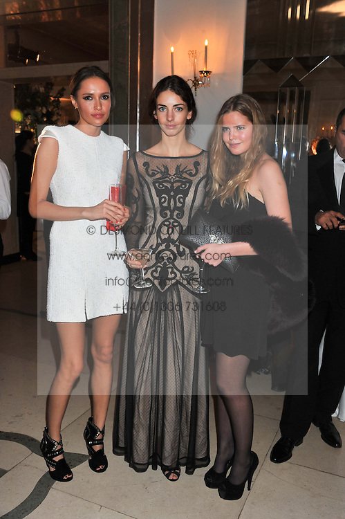 Left to right, SASHA VOLKOVA, the MARCHIONESS OF CHOLMONDELEY and KATIE READMAN at a dinner and dance hosted by Leon Max for the charity Too Many Women in support of Breakthrough Breast Cancer held at Claridges, Brook Street, London on 1st December 2011.