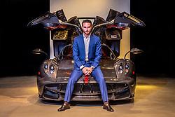Brett David, CEO of Prestige Imports, with his Pagani Huayra, valued at $3 million.