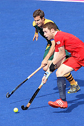 Jonty Clarke of Great Britain takes on Austin Smith of South Africa during the men's hockey match between South Africa and Great Britain held at the Riverbank Arena at Olympic Park in London as part of the London 2012 Olympics on the 1st August 2012..Photo by Ron Gaunt/SPORTZPICS