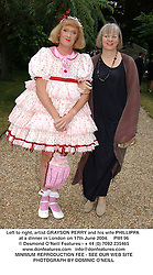 Left to right, artist GRAYSON PERRY and his wife PHILLIPPA. at a dinner in London on 17th June 2004.  PWI 96