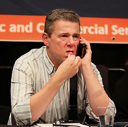 © Licensed to London News Pictures. 13/09/2015. Brighton, UK. PCS General Secretary MARK SERWOTKA  speaking at the Public and Commercial Services Union (PCS) public debate about Fighting Austerity at Brighton's Corn Exchange, a fringe event at the TUC conference. Photo credit : Hugo Michiels/LNP