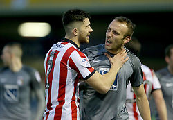 Lincoln City's Sean Long and Coventry City's Liam Kelly clash