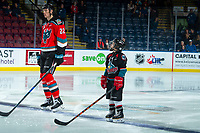 KELOWNA, CANADA - DECEMBER 7:  The Pepsi Player of the game stands on the blue line with Braydyn Chizen #22 of the Kelowna Rockets against the Victoria Royals on December 7, 2018 at Prospera Place in Kelowna, British Columbia, Canada.  (Photo by Marissa Baecker/Shoot the Breeze)