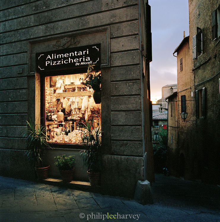 Grocer's window display at night, Siena, Tuscany, Italy