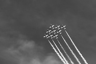 Canadian Forces Snowbirds in a Big Diamond formation with smoke.  The Snowbirds are also known as the 431 Air Demonstration Squadron and fly the Canadair CT-114 Tutor jet. Photographed during the Canada 150 celebrations in White Rock, British Columbia, Canada.