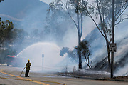 Firefighters douse the hot spots on brush fire near a hill side in Burbank, California, the United States on September 3, 2017. More than 1,000 firefighters battling what the mayor had called the biggest brush fire in the city of Los Angeles history.  (Xinhua/Zhao Hanrong)(Photo by Ringo Chiu)<br /> <br /> Usage Notes: This content is intended for editorial use only. For other uses, additional clearances may be required.
