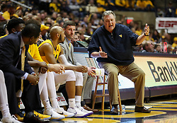 Feb 24, 2018; Morgantown, WV, USA; West Virginia Mountaineers head coach Bob Huggins talks with West Virginia Mountaineers guard Jevon Carter (2) on the bench during the second half against the Iowa State Cyclones at WVU Coliseum. Mandatory Credit: Ben Queen-USA TODAY Sports