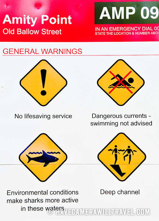 Hazard warning sign at Amity Point on Stradbroke Island. The area has been the site of a number of shark attacks. North Stradbroke Island, just off Queensland's capital city of Brisbane, is the world's second largest sand island and, with its miles of sandy beaches, a popular summer holiday destination.