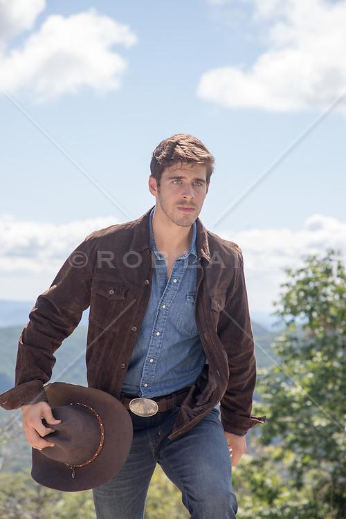 cowboy walking up a hill