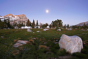 Vogelsang High Camp located in the High Sierras in the Cathedral Range in Yosemite National Park.  A glacial erratic can be observed in the foreground.  Erratics are large boulders that have been moved and deposited away from their origin by glacial activity