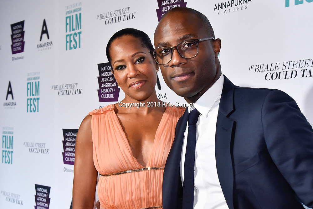 """WASHINGTON, DC - OCTOBER 27: Director/screenwriter Barry Jenkins and actress Regina Hall attend  the closing night screening of """"IF BEALE STREET COULD TALK"""" at the inaugural Smithsonian African American Film Festival 2018 at National Air and Space Museum in Washington DC on October 27th, 2018. (Photo by Kris Connor/Annapurna Pictures)"""