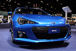 12 February 2015:  2015 SUBARU BRZ: Subaru's 2015 BRZ sports car is offered in BRZ Premium, Limited and new Blue limited-edition models – all with revised suspension damping for improved handling and ride. On display at the 2015 Chicago Auto Show, the Subaru BRZ Series.Blue combines STI functional aerodynamic body design, black-painted STI 17-inch wheels and unique interior trim for a striking look. Subaru will offer 500 of these special models painted WR Blue Pearl and 500 in Crystal White Pearl, all with the six-speed manual transmission and red-painted brake calipers.A redesigned remote transmitter for keyless start system on the BRZ Limited and the Aha Infotainment smartphone integration included with standard navigation system is new updates. Each BRZ wears a low-slung body that combines a swept-back roofline, bulging front fenders, short overhangs and pronounced rear haunches for a lean, athletic stance. The BRZ come stock with the naturally aspirated 2.0-liter four-cylinder Boxer engine that produces 200 horsepower. That engine is not shared with other Subaru models, and can be mated to a new six-speed manual gearbox or optional paddle-shift six-speed automatic transmission, sport-tuned suspension with front strut brace and Torsen limited-slip differential. The BRZ cabin is design for 2+2 seating, with bolstered front sport seats designed just for this car and rear seats that can accommodate front-facing child seats. Behind the three-spoke, leather wrapped steering wheel accented with red stitching, the driver faces easy-to-see instrument panel featuring a large, center-mounted tachometer with an analog speedometer to its left. When additional room is required, the one-piece rear seatback lowers to expand the space offered in the 6.9 cu. ft. trunk to provide enough room to now haul four-wheels, a helmet and basic supplies to weekend slalom or track events.<br /> <br /> First staged in 1901, the Chicago Auto Show is the largest auto show in North America and h