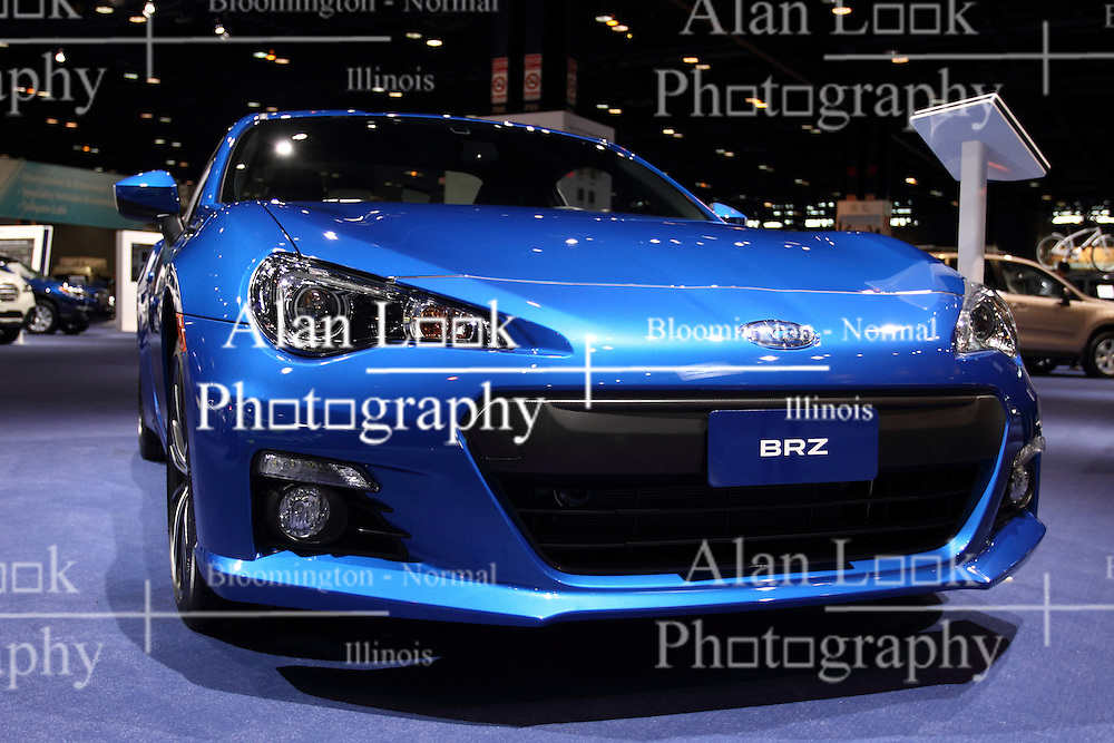 12 February 2015:  2015 SUBARU BRZ: Subaru's 2015 BRZ sports car is offered in BRZ Premium, Limited and new Blue limited-edition models – all with revised suspension damping for improved handling and ride. On display at the 2015 Chicago Auto Show, the Subaru BRZ Series.Blue combines STI functional aerodynamic body design, black-painted STI 17-inch wheels and unique interior trim for a striking look. Subaru will offer 500 of these special models painted WR Blue Pearl and 500 in Crystal White Pearl, all with the six-speed manual transmission and red-painted brake calipers.A redesigned remote transmitter for keyless start system on the BRZ Limited and the Aha Infotainment smartphone integration included with standard navigation system is new updates. Each BRZ wears a low-slung body that combines a swept-back roofline, bulging front fenders, short overhangs and pronounced rear haunches for a lean, athletic stance. The BRZ come stock with the naturally aspirated 2.0-liter four-cylinder Boxer engine that produces 200 horsepower. That engine is not shared with other Subaru models, and can be mated to a new six-speed manual gearbox or optional paddle-shift six-speed automatic transmission, sport-tuned suspension with front strut brace and Torsen limited-slip differential. The BRZ cabin is design for 2+2 seating, with bolstered front sport seats designed just for this car and rear seats that can accommodate front-facing child seats. Behind the three-spoke, leather wrapped steering wheel accented with red stitching, the driver faces easy-to-see instrument panel featuring a large, center-mounted tachometer with an analog speedometer to its left. When additional room is required, the one-piece rear seatback lowers to expand the space offered in the 6.9 cu. ft. trunk to provide enough room to now haul four-wheels, a helmet and basic supplies to weekend slalom or track events.<br /> <br /> First staged in 1901, the Chicago Auto Show is the largest auto show in North America and has been